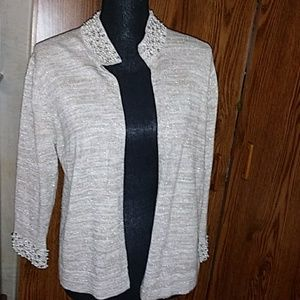 New. A Giannetti tan sweater with beads around the